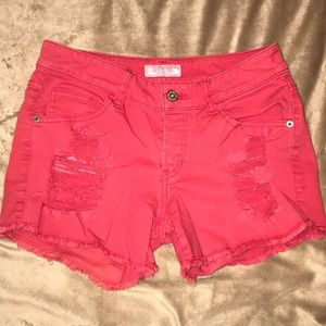 UEC distressed faded red Guess jean shorts